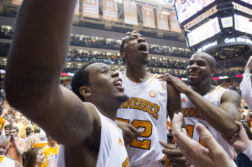 Tennessee forward Kenny Hall (20), guard Jordan McRae (52) and guard Trae Golden (11), left to right, celebrate the Vols' 64-60 win over Missouri in an NCAA college basketball game at Thompson-Boling Arena Saturday, March 9, 2013, in Knoxville, Tenn. (AP Photo/Knoxville News Sentinel, Adam Brimer)
