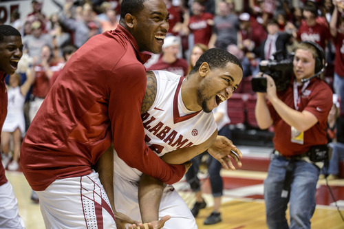 Alabama guard Andrew Steele, left, hugs guard Trevor Releford after Releford hit the game-winning buzzer-beater from 50 feet against Georgia in an NCAA college basketball game Saturday, March 9, 2013, in Tuscaloosa, Ala. Alabama won 61-58. (AP Photo/AL.com, Vasha Hunt) MAGS OUT