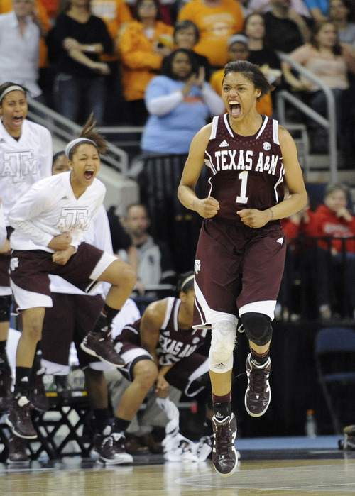 Texas A&M forward Courtney Williams (1) reacts after sinking a basket in the closing moments against Tennessee during the second half of an NCAA college basketball game in the Southeastern Conference tournament on Saturday, March 9, 2013, in Duluth, Ga. Texas A&M won 66-62. (AP Photo/John Amis)