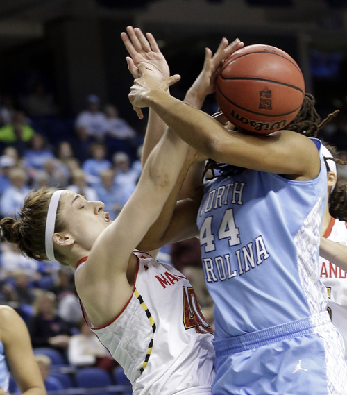 Maryland's Katie Rutan (40) fouls North Carolina's Tierra Ruffin-Pratt (44) during the first half of an NCAA college basketball game at the Atlantic Coast Conference tournament in Greensboro, N.C., Saturday, March 9, 2013. (AP Photo/Chuck Burton)