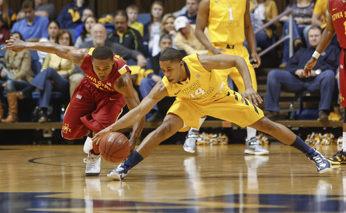 Iowa State's Tyrus McGee, left, and West Virginia's Gary Browne go for a loose ball during the first half of an NCAA college basketball game at WVU Coliseum in Morgantown, W.Va., on Saturday, March 9, 2013. (AP Photo/David Smith)