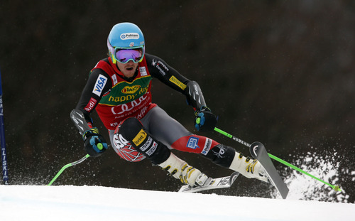 Ted Ligety, of the United States speeds down the course on his way to win an alpine ski, men's World Cup giant slalom, in Kranjska Gora, Slovenia, Saturday, March 9, 2013. (AP Photo/Shinichiro Tanaka)