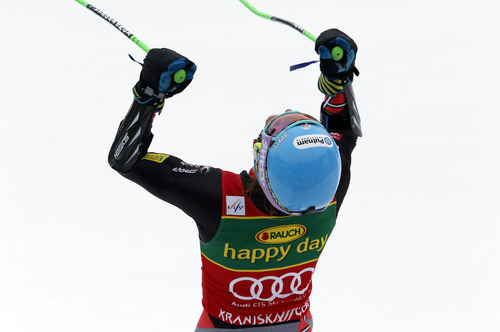 Ted Ligety, of the United States, celebrates after winning an alpine ski, men's World Cup giant slalom, in Kranjska Gora, Slovenia, Saturday, March 9, 2013. (AP Photo/Alessandro Trovati)