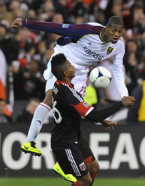 Real Salt Lake defender Chris Schuler, top, and D.C. United forward Lionard Pajoy (26) try to control the ball during the first half of an MLS soccer game, Saturday, March 9, 2013, in Washington. (AP Photo/Richard Lipski)
