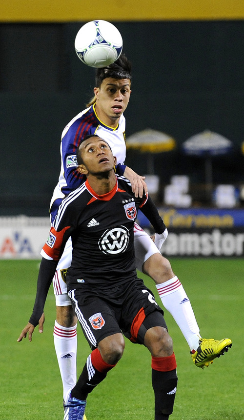 DC United midfielder Marcos Sanchez, bottom, tries to screen the ball away from Real Salt Lake DC midfielder Sebastian Velasquez during the first half of an MLS soccer game on Saturday, March 9, 2013, in Washington. DC United defeated Real Salt Lake 1-0. (AP Photo/Richard Lipski)