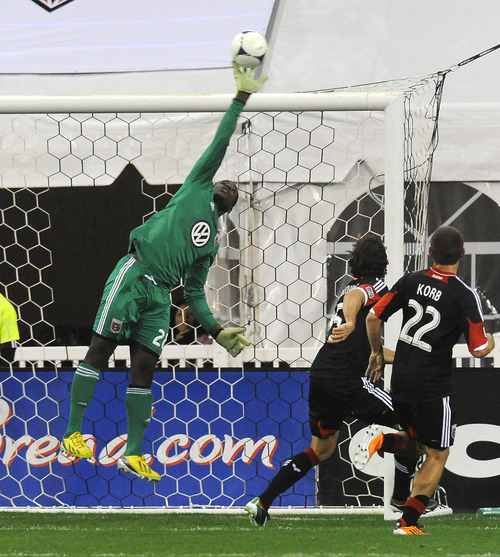 DC United goalie Bill Hamid, left, makes a save on-goal during first half of an MLS soccer game against Real Salt Lake, Saturday, March 9, 2013, in Washington. DC United defeated Real Salt Lake 1-0. (AP Photo/Richard Lipski)