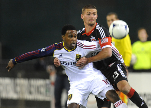 Real Salt Lake forward Robbie Findley (10) and DC United midfielder Perry Kitchen (23) wrestle for control of the ball during first half of their MLS soccer game on Saturday, March 9, 2013, in Washington. DC United defeated Real Salt Lake 1-0. (AP Photo/Richard Lipski)