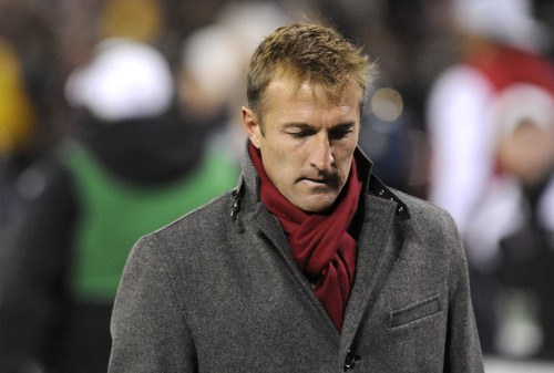 Real Salt Lake head coach Jason Kreis walks off the field after they lost to DC United 1-0 in an MLS soccer game on Saturday, March 9, 2013, in Washington. (AP Photo/Richard Lipski)
