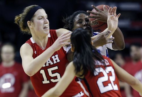 Utah's Michelle Plouffe, left, battles for the ball with UCLA's Jasmine Dixon, upper right, as Utah's Danielle Rodriguez (22) looks on during the first half of an NCAA women's college basketball game in the Pac-12 Conference tournament, Friday, March 8, 2013, in Seattle. UCLA beat Utah 54-43. (AP Photo/Ted S. Warren)