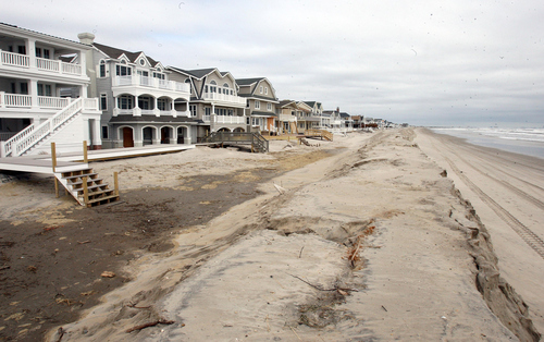 The dune structure created along the south end of Ocean City, N.J, beaches helps keep back the high tides created by an overnight storm Thursday, March 7,  2013.  (AP Photo/The Press of Atlantic City, Dale Gerhard)