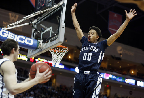 San Diego's Christopher Anderson leaps to block an inbound pass during the second half of a West Coast Conference tournament NCAA college basketball game against BYU on Friday, March 8, 2013, in Las Vegas. San Diego defeated BYU 72-69. (AP Photo/Isaac Brekken)