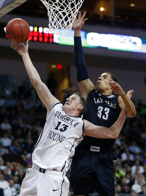 BYU's Brock Zylstra shoots covered by San Diego's Jito Kok during the second half of a West Coast Conference tournament NCAA college basketball game on Friday, March 8, 2013, in Las Vegas. San Diego defeated BYU 72-69. (AP Photo/Isaac Brekken)