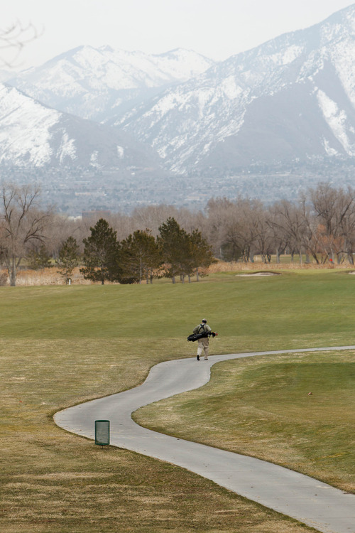 Trent Nelson  |  The Salt Lake Tribune Golfers brave the chill at the Meadow Brook Golf Course Thursday March 7, 2013 in Salt Lake City