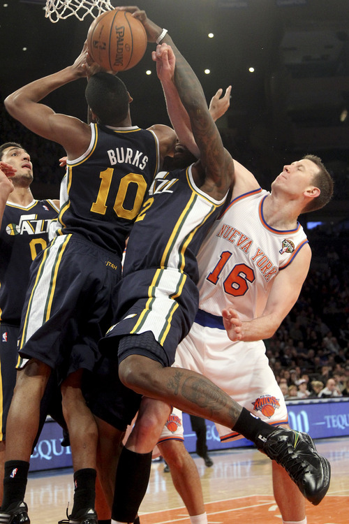 New York Knicks' Steve Novak (16) fights for a rebound against Utah Jazz's Alec Burks (10) and Marvin Williams (2) during the first half of an NBA basketball game on Saturday, March 9, 2013, at Madison Square Garden in New York. (AP Photo/Mary Altaffer)