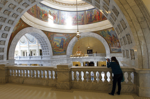 Al Hartmann     The Salt Lake Tribune The Utah State Capitol's upcoming 100th anniversary is being celebrated with new displays. A person appears small as she takes a picture from the fourth floor looking down into the Capitol rotunda Tuesday March 5.