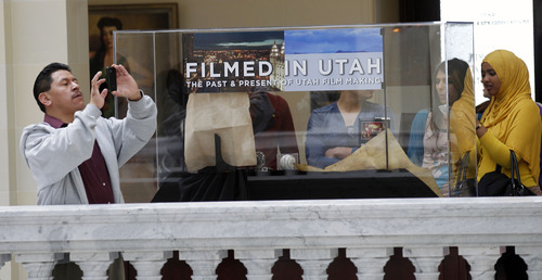 Al Hartmann     The Salt Lake Tribune The Utah State Capitol's upcoming 100th anniversary is being celebrated with new displays. Foreign tourists take in the displays and artwork on the fourth floor of the Capitol Tuesday March 5.