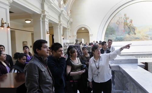 Al Hartmann     The Salt Lake Tribune The Utah State Capitol's upcoming 100th anniversary is being celebrated with new displays. Sandra White, right, a retired school teacher, leads a tour of the Capitol to a group of tourists from Latin America Tuesday March 5.