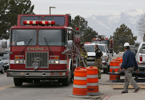 Provo fire men work a fire at a construction site on the east side of the Monte L. Bean Life Science Museum on the campus of Brigham Young University on March 11, 3013 in Provo. (Photo by George Frey)