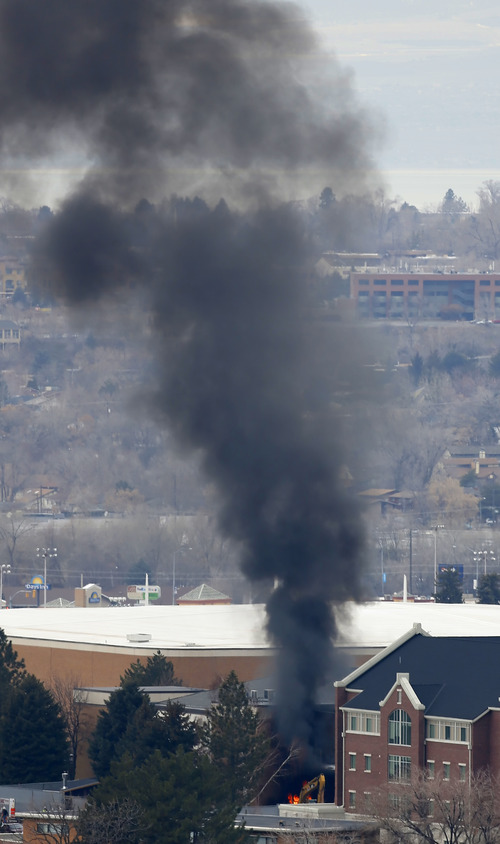 Black smoke and flames rises from a construction site on the east side of the Monte L. Bean Life Science Museum on the campus of Brigham Young University on March 11, 3013 in Provo. (Photo by George Frey)