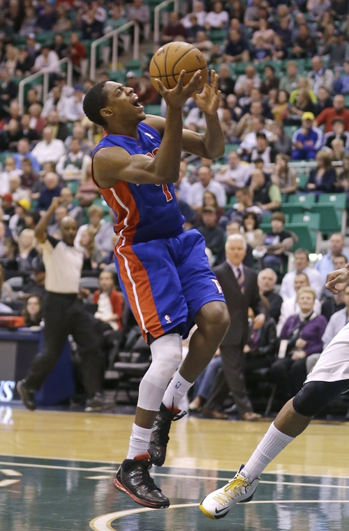 Detroit Pistons' Brandon Knight (7) grimaces after being injured as he drives to the basket  in the first quarter during an NBA basketball game against the Utah Jazz Monday, March 11, 2013, in Salt Lake City.  (AP Photo/Rick Bowmer)