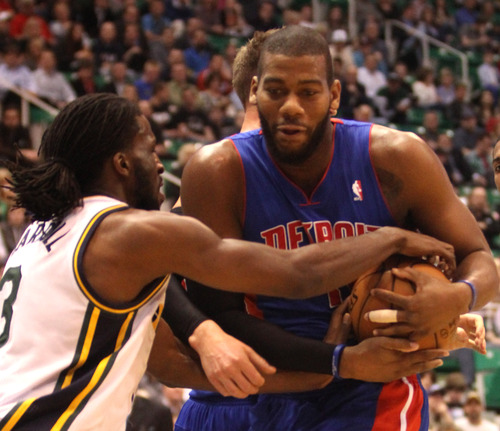Rick Egan  | The Salt Lake Tribune   Utah Jazz small forward DeMarre Carroll (3) grabs the ball along with Detroit Pistons center Greg Monroe (10), in NBA action, Utah vs. Detroit, at EnergySolutions Arena, Monday, March 11, 2013.