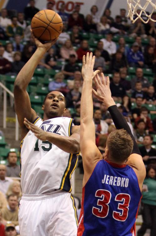 Rick Egan    The Salt Lake Tribune   Utah Jazz power forward Derrick Favors (15) shoots over Detroit Pistons power forward Jonas Jerebko (33), in NBA action, Utah vs. Detroit, at EnergySolutions Arena, Monday, March 11, 2013.