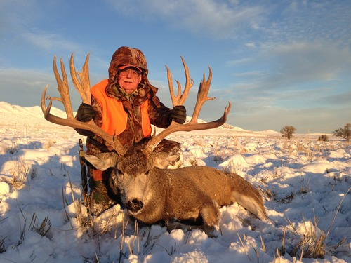Courtesy MossBack Outfitters Dennis Austad, of Ammon, Idaho, paid $160,000 to hunt for mule deer on Antelope Island in 2012. He took this big buck in November. Austad paid a record $310,000 for the right to hunt a buck mule deer again on Antelope Island in 2013.