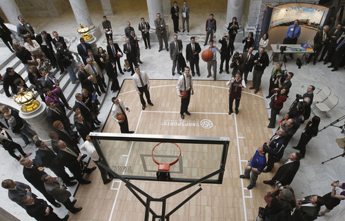 Al Hartmann  |  The Salt Lake Tribune Utah Governor Gary Herbert at right corner of court throws up a jump shot with members of the Lone Peak High School Basketball Team on a basketball court in the state capitol rotunda Friday March 8. Thye team was honored in the house of representatives, senate and the governor for their accomplishments. The Lone Peak basketball team is going down in the history books as one of the best high school basketball teams in Utah. The team just recently won the 5A State Championship, and is representing Utah as the number one ranking high school team in the nation.