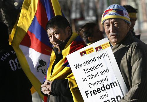 Scott Sommerdorf  |  The Salt Lake Tribune Tsering Tasji, left, and Thondup Dorjee are among the audience as the Tibetan community of Utah observed the 54th worldwide commemoration of National Tibetan Uprising Day at the Wallace Bennett Federal Building, Sunday, March 10, 2013. On this date in 1959, tens of thousands of Tibetans took to the streets of Lhasa, Tibet's capital, rising up against China's illegal invasion and occupation of their homeland.