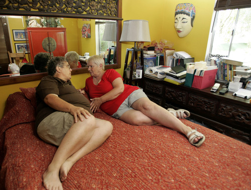 Judy Rickard, left, with her partner, Karin Bogliolo, right, in the bedroom at their home in San Jose, Calif., Thursday, July 2, 2009. Facing a painful separation, Rickard, 61, retired early from her job at San Jose State University this past April and took a reduced pension so that she could spend more time with her partner, Bogliolo, a citizen of Great Britain who is allowed to stay in the U.S. for up to six months at a time. It was not the preferred option. Rickard wanted to keep working and sponsor Bogliolo for residency in the United States, just as married heterosexual couples can. But U.S. law does not allow for that. (AP Photo/Paul Sakuma)