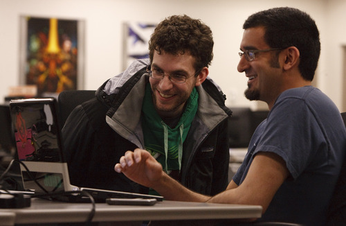 Leah Hogsten  |  The Salt Lake Tribune Jason Thummel and Jason Kanagaratnam share a laugh Friday while filling out a job application. The University of Utah's Entertainment Arts and Engineering programs were ranked No. 1 in the country for undergraduates and No. 2 for graduates.