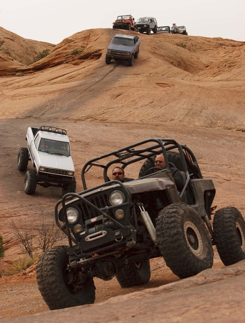 Moab - Jeeps and 4x4's on the Hell's Revenge 4x4 Trail, as thousands of Jeeps descended on the trails surrounding Moab for the annual Easter Jeep Safari, Friday April 10, 2009. Trent Nelson/The Salt Lake Tribune; 4.10.2009.