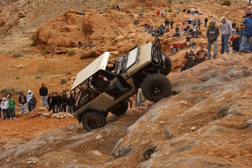 Moab - A 4x4 climbs up Potato Salad Hill. Thousands of Jeeps descended on the trails surrounding Moab for the annual Easter Jeep Safari, Saturday April 11, 2009. Trent Nelson/The Salt Lake Tribune; 4.11.2009.