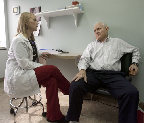 Steve Griffin | The Salt Lake Tribune MarLynn James, 79, of Cedar Hills, talks with Heather McClain, a clinical research coordinator, during his visit to Advanced Clinical Research in West Jordan. James is a trial participant in a weight loss medication at the center, which conducts industry-funded trials.