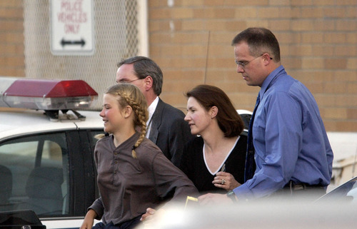 Francisco Kjolseth  |  The Salt Lake Tribune  Elizabeth Smart, accompanied by her mother Lois and two unidentified men gets rushed into an unmarked van from the Salt Lake City Police department and taken to her home.  Elizabeth Smart who was abducted last June was found alive and well in Sandy on March 12, 2003.
