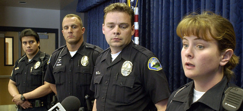 Steve Griffin  |  The Salt Lake Tribune  Sandy City police officers (left to right) Victor Quezada, Bill O'Neal, Troy Rasmussen and Karen Jones, who were the first officers on the scene when Elizabeth Smart was found, talk during a press conference in the Sandy City police headquarters March 13, 2003.