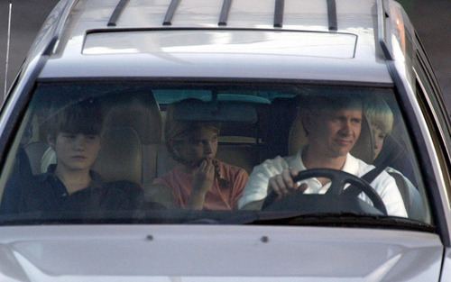 Leah Hogsten  |  The Salt Lake Tribune  Ed Smart and his children Andrew (left), Edward (unseen, backseat,left)  Mary Catherine (center) and Charles (right, backseat) follow the unmarked van containing Elizabeth Smart and her mother Lois leaving the Salt Lake Police Department Wednesday March 12, 2003. Elizabeth Smart was abducted from her home last June and found today by Sandy, Utah police around 1p.m.