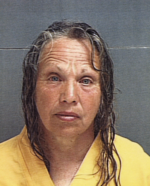 Wanda Ilene Barzee poses for her police booking mug Wednesday, March 12, 2003, in Salt Lake City. Barzee, 57, arrested in the Elizabeth Smart case, once decorated cakes professionally and worked as a beautician, but her family says she began wearing odd robes and panhandling after she married drifter Brian David Mitchell. Barzee became devoted to the self-proclaimed prophet, relatives said, and the couple sold their belongings and were often seen begging at Mormon church headquarters. (AP Photo/Salt Lake County Sheriff)