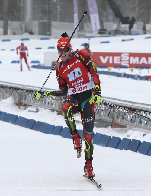 Third placed Czech relay team member Ondrej Moravec jokes as he finishes in the men's 4X7.5 km Relay at the Laura biathlon stadium in the Olympic mountain cluster during the IBU World Cup Biathlon in Sochi, Russia, Sunday, March 10, 2013. (AP Photo/Mikhail Metzel)