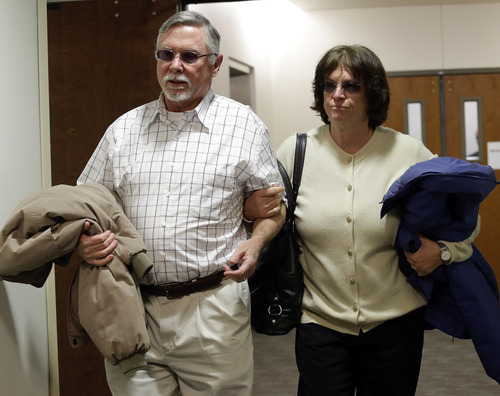 James Holmes parents Robert and Arlene Holmes arrive at district court for the arraignment of  their son Aurora theater shooting suspect James Holmes in Centennial, Colo., on Tuesday, March 12, 2013. The judge has entered a not guilty on behalf of James Holmes after his lawyer said he's not ready to enter a plea. Holmes is charged with killing 12 people and wounding more than 50 in a crowded Colorado movie theater last year. (AP Photo/Ed Andrieski)