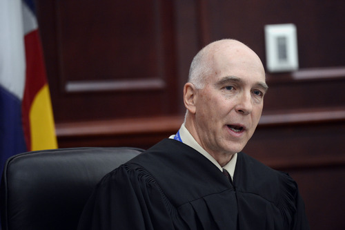Judge William Blair Sylvester speaks during James Holmes' arraignment, where he entered a guilty plea for Holmes, in district court in Centennial, Colo., on Tuesday, March 12, 2013. Sylvester entered a not guilty plea on behalf of James Holmes after the former graduate student's defense team said he was not ready to enter one. (AP Photo/Denver Post, RJ Sangosti, Pool)