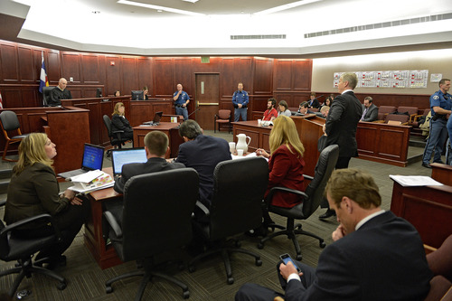 District Attorney George Brauchler, standing at podium, addresses the court during the arraignment of James Holmes, Aurora theater shooting suspect, in Centennial, Colo., on Tuesday, March 12, 2013. Judge William Blair Sylvester entered a not guilty plea on behalf of James Holmes on Tuesday after the former graduate student's defense team said he was not ready to enter one. (AP Photo/Denver Post, RJ Sangosti, Pool)