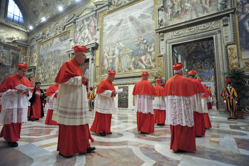 In this picture released by the Vatican newspaper L'Osservatore Romano, cardinals enter the Sistine Chapel prior to the start of the conclave, at the Vatican, Tuesday, March 12, 2013. Cardinals from around the globe locked themselves inside the Sistine Chapel on Tuesday to choose a new leader for the world's 1.2 billion Catholics and their troubled church, surrounded by Michelangelo's imposing frescos imagining the beginning and the end of the world. (AP Photo/L'Osservatore Romano, ho)