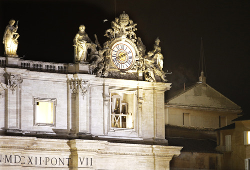 Black smoke emerges from the chimney on the roof of the Sistine Chapel, in St. Peter's Square at the Vatican, Tuesday, March 12, 2013. The black smoke indicates that the new pope has not been elected by the cardinals. (AP Photo/Andrew Medichini)
