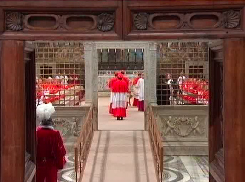 """In this image taken from video provided by CTV, cardinals line up to place their hands on the Gospel to """"promise pledge and swear"""" to keep the oath of secrecy before taking their seats for the conclave to elect the next pope inside the Sistine Chapel in Vatican City Tuesday, March 12, 2013. (AP Photo/CTV)"""