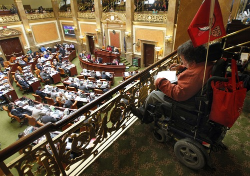 Al Hartmann  |  The Salt Lake Tribune Louis Fazio, with the Coalition with People with Disabilites follows the debate of HB391S2, Prohibition of Medicaid Expansion from his wheelchair in the gallery above the Utah House of Representatives Monday March 11.