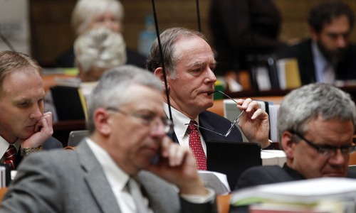 Al Hartmann  |  The Salt Lake Tribune Rep. Earl Tanner, R-West Jordan, center, listens to the debate with other Republicans of HB391S2, Prohibition of Medicaid Expansion in the Utah House of Representatives Monday March 11.
