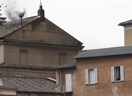 Black smoke emerges from the chimney on the Sistine Chapel as cardinals voted on the second day of the conclave to elect a pope in St. Peter's Square at the Vatican, Wednesday, March 13, 2013. Black smoke indicates that no pope was elected. (AP Photo/Andrew Medichini)