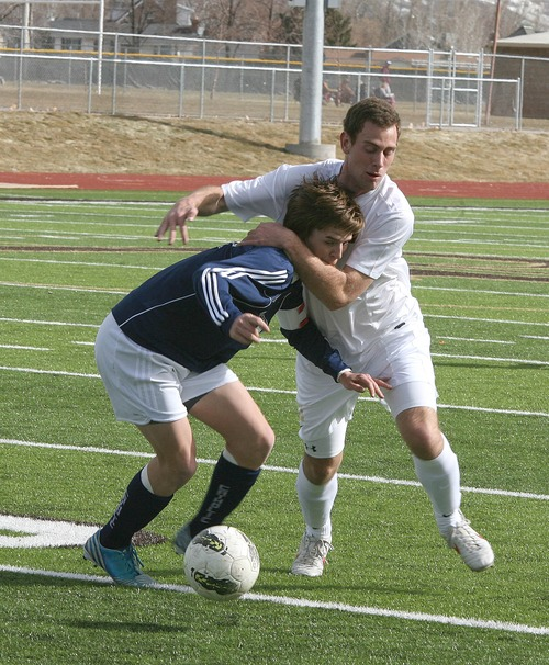 Paul Fraughton  |   Salt Lake Tribune Davis High's Mitch Parkinson gets Juan Diego's Michael Kelliiher in a head lock as they  vie for possession of the ball.  Monday, March 11, 2013