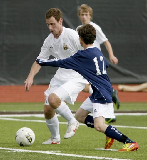 Paul Fraughton  |   Salt Lake Tribune Davis High's Mitch Parkinson  dribbles the ball past  Juan Diego defender Garrett Albright.  Monday, March 11, 2013